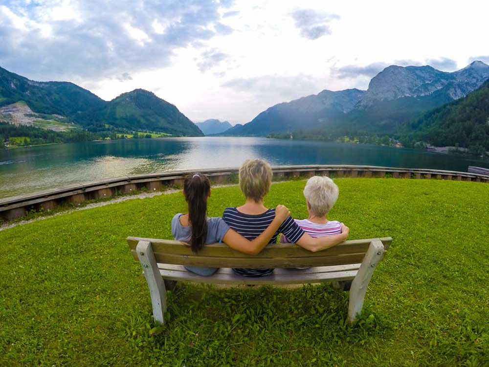 austria three generation on a bench